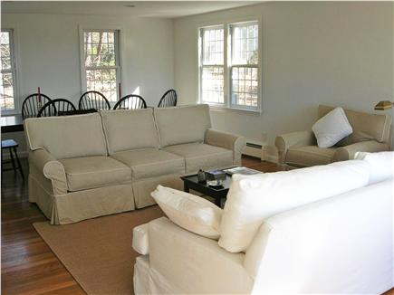 Chatham Cape Cod vacation rental - Living Room with fireplace and French door to side deck