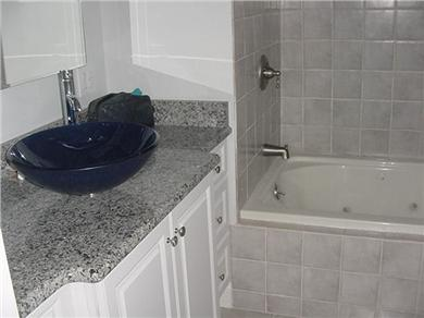 Eastham Cape Cod vacation rental - Master bathroom with oversized tub and granite counter top
