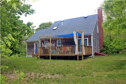 Brewster Cape Cod vacation rental - Outdoor shower, deck including Weber Grill and dining area