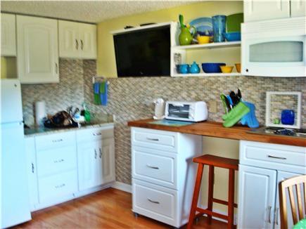 West Dennis Cape Cod vacation rental - Kitchen has 2 burner stove, microwave, coffee maker, TV etc.
