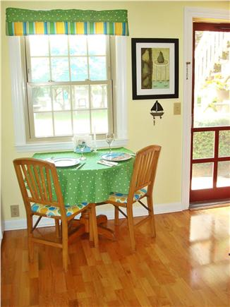 West Dennis Cape Cod vacation rental - dining area looks out to courtyard and pool