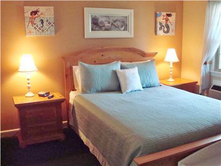 West Dennis Cape Cod vacation rental - Comfortable queen bedroom has a TV &  porch overlooking the pool