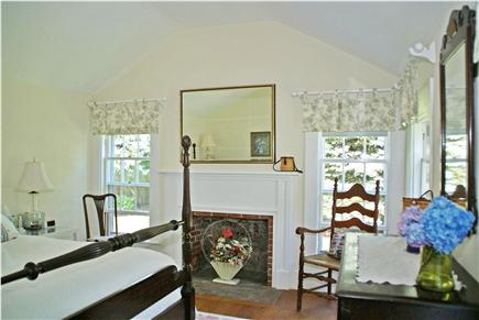 Harwichport, near Bank Street  Cape Cod vacation rental - First floor master bedroom with fireplace