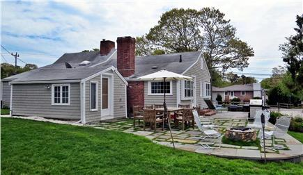 Hyannis Cape Cod vacation rental - Gosnold Manor backyard stone patio and fire pit
