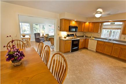 Mashpee Cape Cod vacation rental - Large Eat-In Kitchen Opens to Attached Sunroom and Living Room