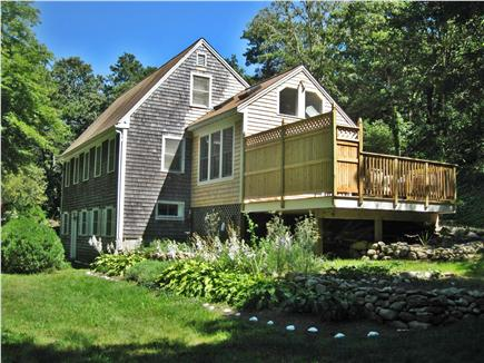 Brewster Cape Cod vacation rental - Side view with sunroom and deck