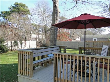 West Yarmouth Cape Cod vacation rental - Deck overlooking large backyard, great for dining