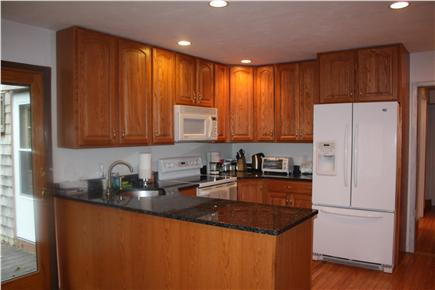 Falmouth Cape Cod vacation rental - Modern kitchen with sliding door to deck