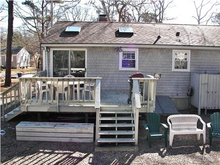 Popponesset Beach in Mashpee,  Cape Cod vacation rental - Backyard Deck and outdoor shower stall