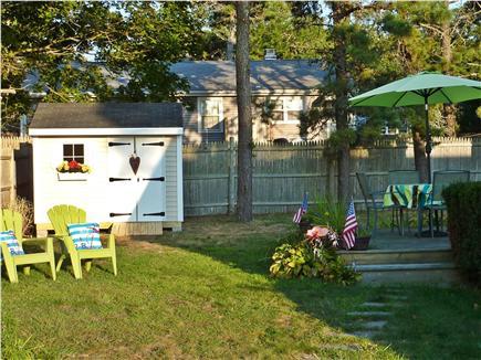 Dennisport Cape Cod vacation rental - Large level yard with Deck