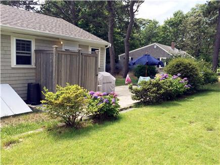 Dennis, Beach Street @ Mayflower beach Cape Cod vacation rental - Large outside shower,patio, grill/table FOR dining.
