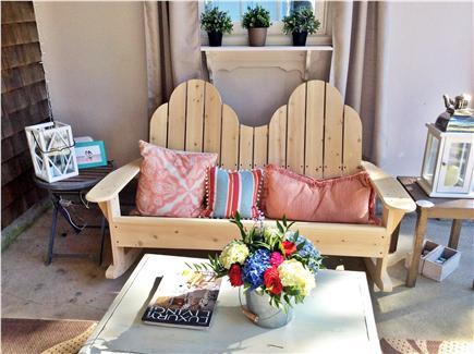 Dennis, Beach Street @ Mayflower beach Cape Cod vacation rental - Covered side porch with aridondack rocking sofa.