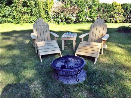 Dennis, Beach Street @ Mayflower beach Cape Cod vacation rental - Adirondacks on side porch and in the yard.