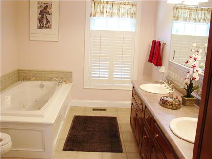 Brewster Cape Cod vacation rental - Downstairs master suite with 6' Jacuzzi and double sink.