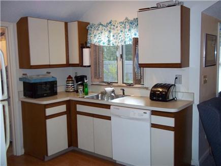 Dennis Port Cape Cod vacation rental - Kitchen with microwave, fridge, stove, & dishwasher.