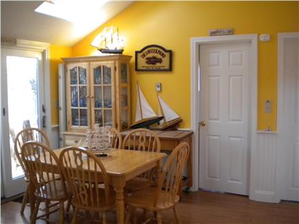 Dennis Port Cape Cod vacation rental - Dining room area with slider leading out to fenced-in back yard.