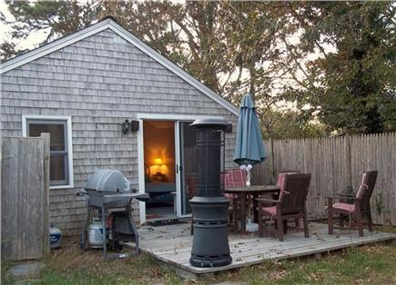 Dennis Port Cape Cod vacation rental - Back patio area with outdoor shower to left.