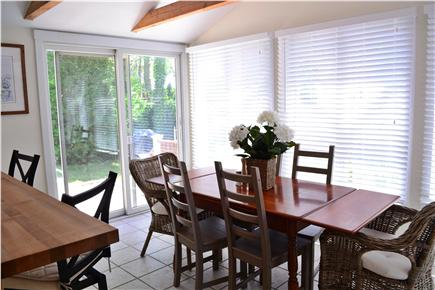 Falmouth Cape Cod vacation rental - Breakfast bar, dining area with cathedral ceiling, patio beyond