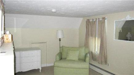 North Eastham Cape Cod vacation rental - Another view of fireplace bedroom w/ over-sized chair (2nd floor)