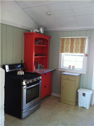 Chatham Cape Cod vacation rental - Gas range and ''lobster pink'' hutch