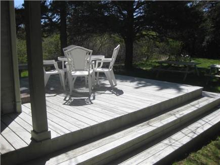 Brewster Cape Cod vacation rental - Backyard and deck with new outdoor shower & fire pit