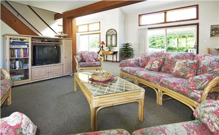 Mashpee Cape Cod vacation rental - Partial view of the living room and it's access to the back deck