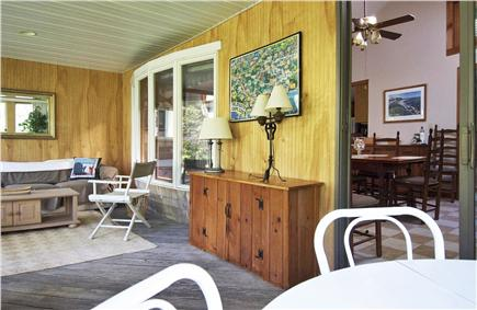 Mashpee Cape Cod vacation rental - Front enclosed sunroom with 5 sliders and a pull out couch.