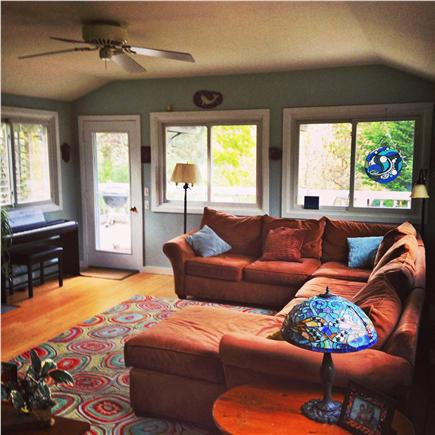 Eastham Cape Cod vacation rental - Bright living room w/3 walls of windows & access to deck & garden