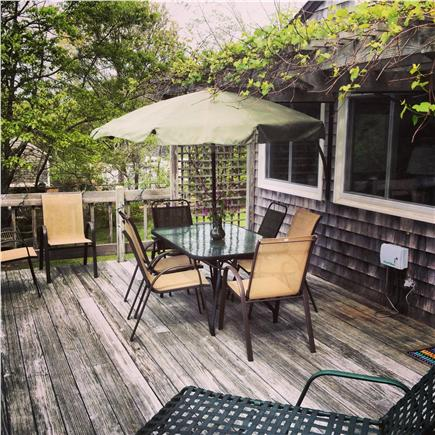 Eastham Cape Cod vacation rental - Sunny back deck with lush grapevine arbor
