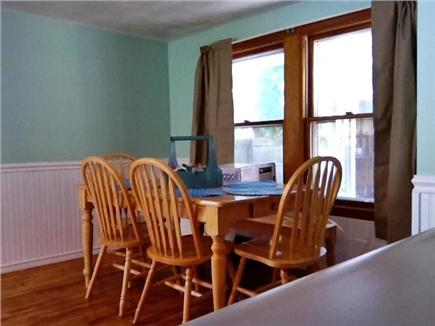 South Dennis Cape Cod vacation rental - Dining room centrally nestled between kitchen & living rm