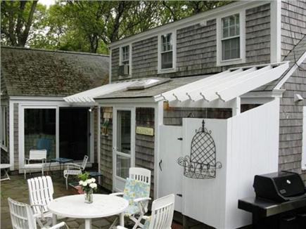 Harwichport Cape Cod vacation rental - Backyard Patio with Grill and Dining Area, great for entertaining