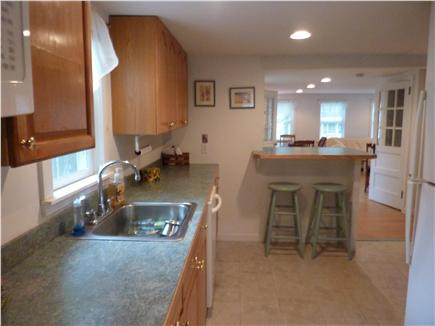 West Harwich Cape Cod vacation rental - Galley Kitchen with Island Nook with Stools