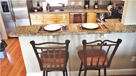 West Harwich Cape Cod vacation rental - View of kitchen from barstools