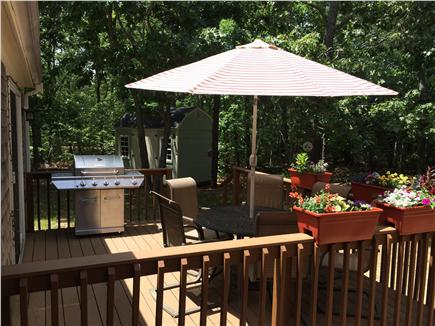 Eastham Cape Cod vacation rental - Deck with gas grill, seating for  and a shed to store your bikes