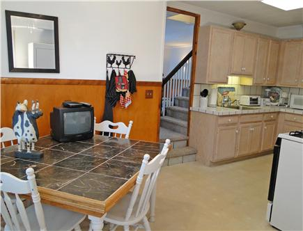Onset on Water Street Inlet MA vacation rental - Southside Compact Kitchen/Dining Area w/ Laundry, Bath & RearHall