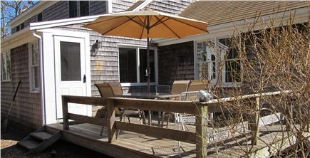 North Eastham Cape Cod vacation rental - Backyard deck with seating