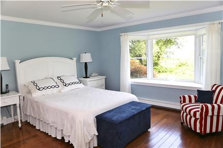 Brewster Cape Cod vacation rental - First floor master with a bathroom off to the left.