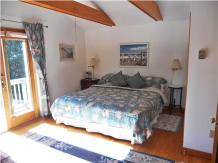 Chatham Cape Cod vacation rental - Second floorMaster Bedroom with slider to deck overlooking patio.