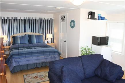 Bourne, Monument Beach Cape Cod vacation rental - Queen bed in studio cottage.  Love seat looks out over water.