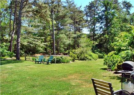Eastham Cape Cod vacation rental - Side yard, rear view from the patio