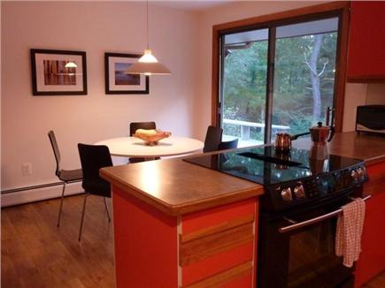 West Brewster Cape Cod vacation rental - Cozy dining area between kitchen and deck.