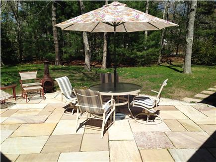 Eastham Cape Cod vacation rental - Slate patio in private yard with Weber grill and chiminea
