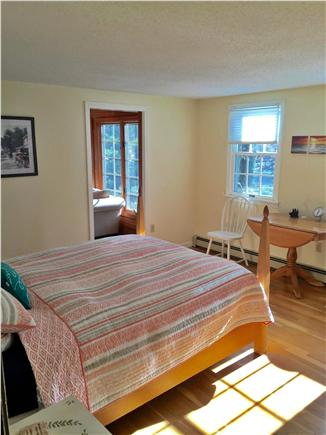 Eastham Cape Cod vacation rental - Queen bedroom with pocket door into sunroom