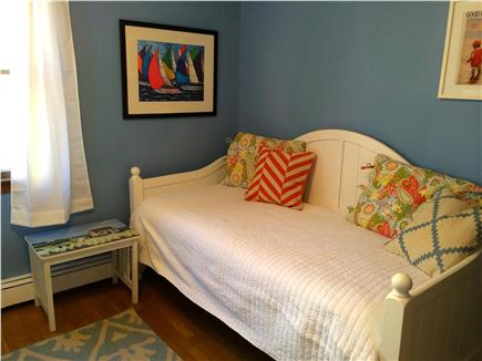 West Yarmouth Cape Cod vacation rental - Daybed, compfy chair and a well-stocked bookshelf await you.