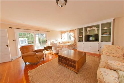 Yarmouth Cape Cod vacation rental - Family room with television, sliders to outdoor patio