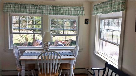 Eastham Cape Cod vacation rental - Dining room overlooking patio and gardens- so private