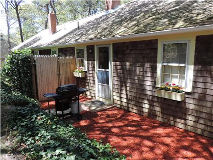 West Chatham Cape Cod vacation rental - Backyard grill area, Outside enclosed shower in left background