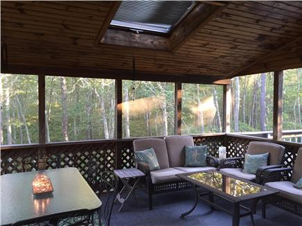 Dennis Cape Cod vacation rental - Relaxing screened in porch and open deck.