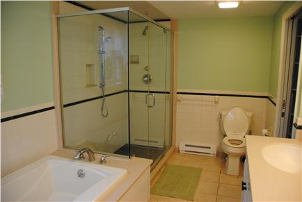 East Orleans Cape Cod vacation rental - Master Bathroom with double sinks, shower, and tub.