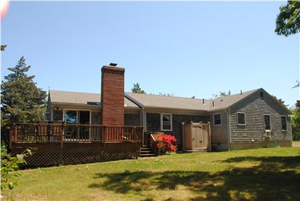 East Orleans Cape Cod vacation rental - Backyard with raised deck and outdoor shower!